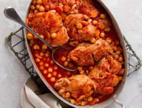 Chicken stew or ragout with nuts, carrot and tomato sauce, selective focus